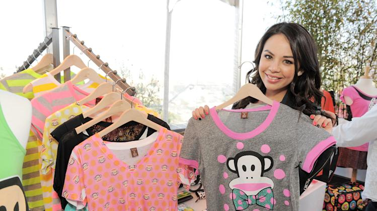 "IMAGE DISTRIBUTED FOR SABAN BRANDS - Janel Parrish checks out the Paul Frank 2013 Summer Collection at the ""Let's Have a Fun Day"" event, on Monday, April, 8th, 2013, in Los Angeles. (Photo by Jordan Strauss/Invision for Saban Brands/AP Images)"