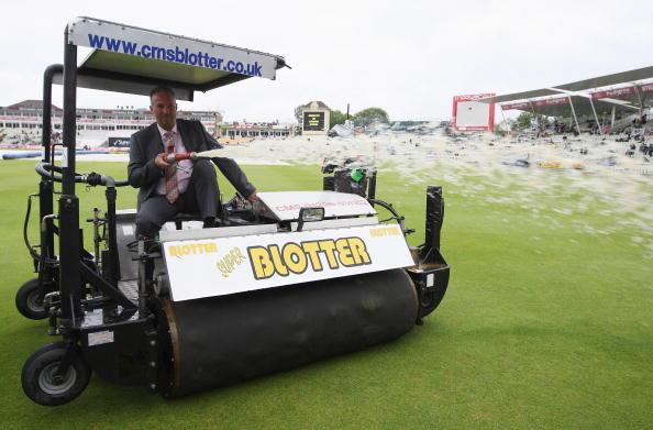 BIRMINGHAM, UNITED KINGDOM - AUGUST 01: Sky commentator Ian Botham sprays water over the boundary from the Blotter after rain during day three of the npower 3rd Ashes Test Match between England and Au