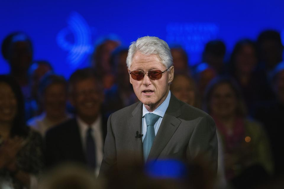 Former U.S. President Clinton does an impression of artist Bono during the Clinton Global Initiative in New York