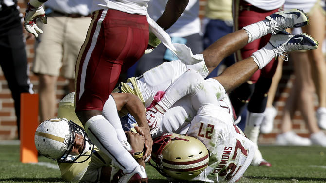 Georgia Tech quarterback Tevin Washington, left, dives into the end zone to score a touchdown against the defense of Boston College defensive back Justin Simmons right, in the first quarter of an NCAA college football game Saturday, Oct. 20, 2012, in Atlanta.  Georgia Tech won 37-17. (AP Photo/David Goldman)