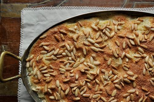 Airy Citrus Rosemary Pignole Bread Pudding