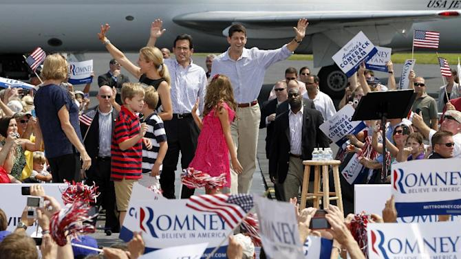 Republican vice presidential candidate Rep. Paul Ryan, R-Wis., right and House Majority Leader Eric Cantor of Va., left, wave to the crowd as they arrive for a rally at the airport in Richmond, Va., Friday, Aug. 31, 2012.  ( AP Photo/Steve Helber)