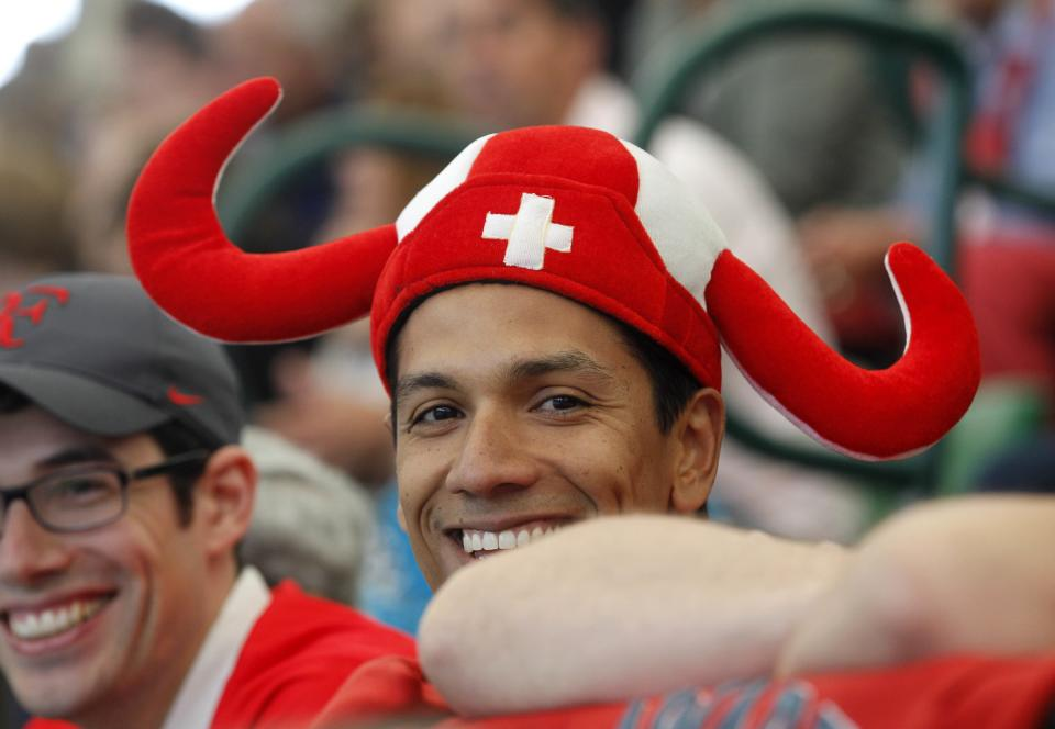 A Roger Federer fan watches the  semifinal match between Swiss Roger Federer and Russian Mikhail Youzhny at the Gerry Weber Open ATP  tennis tournament in Halle, western Germany, Saturday June 16, 2012.  Federer won by 6-1 and 6-3. (AP Photo/dapd/Joerg Sarbach)
