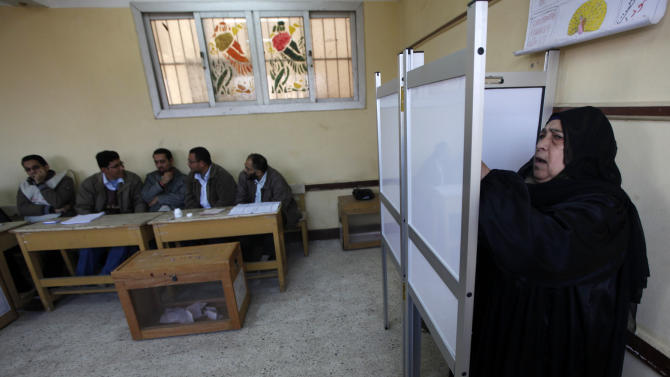 An Egyptian woman votes at a polling center during the third round of the elections for Egypt's parliament, in Qalyobeia, Egypt Tuesday, Jan. 3, 2012. Egyptians lined up in front of polling centers in nine provinces to cast their ballots Tuesday in the third round of the country's first parliamentary elections following the ouster of Hosni Mubarak.(AP Photo/Khalil Hamra)