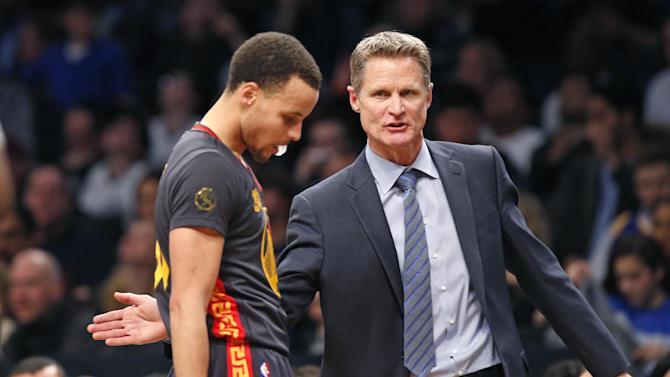 Golden State Warriors head coach Steve Kerr consoles Golden State Warriors guard Stephen Curry (30) in the second half of an NBA basketball game against the Brooklyn Nets at the Barclays Center, Monday, March 2, 2015, in New York. The Nets defeated the Warriors 110-108. (AP Photo/Kathy Willens)