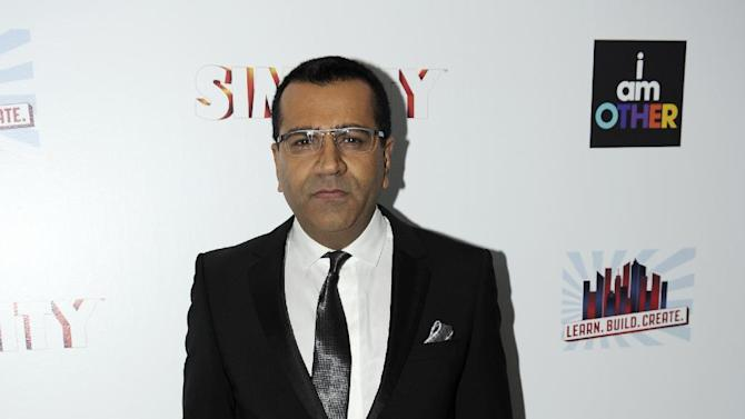Martin Bashir arrives at the EA SimCity Learn. Build. Create. Inauguration After-Party, Tuesday, Jan. 22, 2013, in Washington. (Photo by Nick Wass/Invision for EA/AP Images)