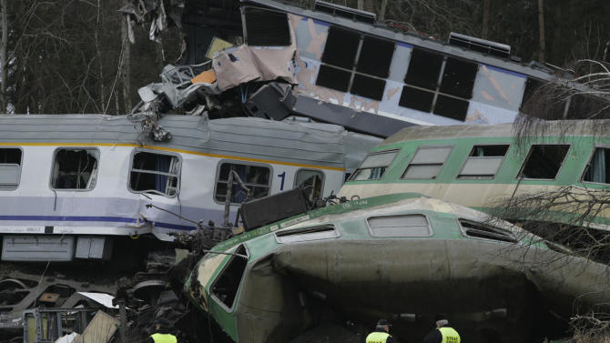 The wreckage of collided trains lies, in Szczekociny, southern Poland, Sunday, March 4, 2012. Polish prosecutors have opened an investigation into how a train ended up on the wrong tracks after two engines collided head on late Saturday, killing 15 people and leaving 54 in hospitals. (AP Photo/Michal Legierski) POLAND OUT