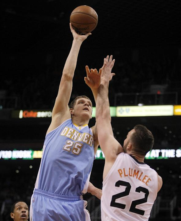 Denver Nuggets center Timofey Mozgov (25) shoots over Phoenix Suns center Miles Plumlee (22) in the second quarter during an NBA basketball game, Sunday, Jan. 19, 2014, in Phoenix