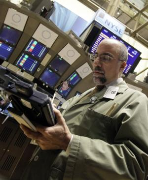 In this Jan. 25, 2011 photo, trader John Liotti works on the floor of the New York Stock Exchange. (AP Photo/Richard Drew)