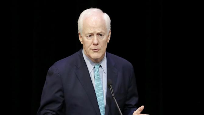 FILE - In this Oct. 24, 2014 file photo, Senate Majority Whip John Cornyn of Texas speaks in Dallas. Cornyn, the author of a bill to combat human trafficking is proposing a compromise to resolve a partisan dispute over abortion funding that has hung up in legislation.  (AP Photo/Tony Gutierrez)