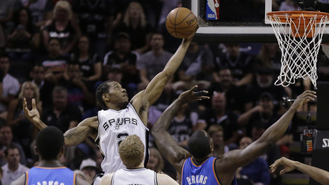 San Antonio Spurs' Kawhi Leonard grabs a defensive rebound against the Oklahoma City Thunder during the first half of Game 5 of the Western Conference finals NBA basketball playoff series, Thursday, May 29, 2014, in San Antonio. (AP Photo/Eric Gay)