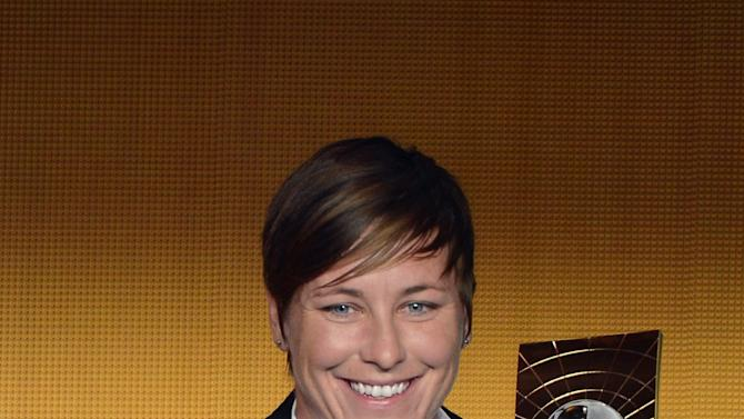 US soccer player Abby Wambach poses with the trophy after winning the FIFA Women's World Player of the Year Award during the FIFA Ballon d'Or Gala 2013 held at the Kongresshaus in Zurich, Switzerland,  Monday, Jan 7, 2013. (AP Photo/Keystone, Walter Bieri)