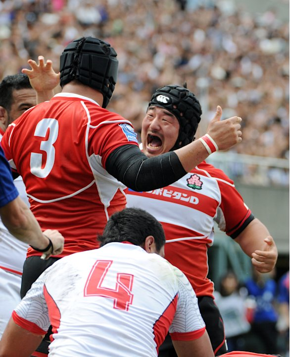 Japan's Yusuke Nagae (R) and teammate Hi