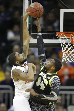 Baylor forward Cory Jefferson (34) blocks a shot by Oklahoma State guard Markel Brown during the first half of an NCAA college basketball game in the Big 12 tournament on Thursday, March 14, 2013, in Kansas City, Mo. (AP Photo/Orlin Wagner)