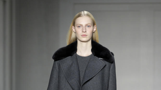 The Reed Krakoff Fall 2013 collection is modeled during Fashion Week in New York, Wednesday, Feb. 13, 2013.  (AP Photo/Seth Wenig)