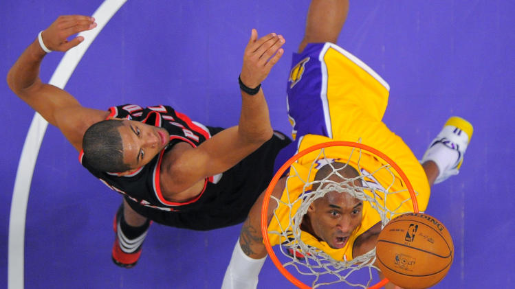 Los Angeles Lakers guard Kobe Bryant, right, puts up a shot as Portland Trail Blazers forward Nicolas Batum, of France, defends during the first half of their NBA basketball game, Friday, Feb. 22, 2013, in Los Angeles. (AP Photo/Mark J. Terrill)