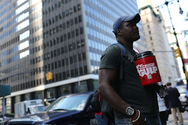 "NEW YORK, NY - JULY 09:  Eric Moore attends a protest billed as the `'Million Big Gulp March"" in lower Manhattan which is opposed to Mayor Michael Bloomberg's proposal to prohibit licensed food service establishments from using containers larger than 16 ounces on July 9, 2012 in New York City. In an attempt by the administration to fight obesity, New York City Mayor Michael Bloomberg announced plans recently to implement a ban on the sale of large sodas and other sugary drinks at restaurants, movie theaters and street carts. The ban has proved controversial with many people saying it will not decrease obesity and will be a further erosion of personal choice.  (Photo by Spencer Platt/Getty Images)"