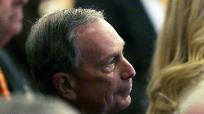 New York City Mayor Michael Bloomberg listens as New York Gov. Andrew Cuomo delivers his third State of the State address at the Empire State Plaza Convention Center on Wednesday  Jan. 9, 2013, in Albany, N.Y. (AP Photo/Mike Groll)