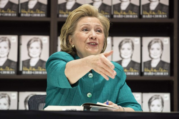 "Former U.S. Secretary of State Hillary Clinton greets people as she signs copies of her book ""Hard Choices"" at a Costco store in Arlington, ..."