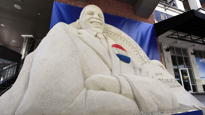 A sand sculpture created in the likeness of President Barack Obama is on display in downtown, Sunday, Sept. 2, 2012, in Charlotte, N.C.  (AP Photo/Chuck Burton)