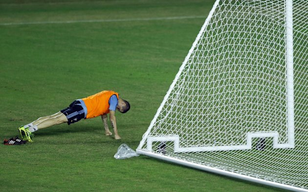 Spain's Fernando Torres does push-ups during a training session in Rio de Janeiro, Brazil, Monday, June 17, 2013. Brazil is hosting the Confederations Cup June 15-30