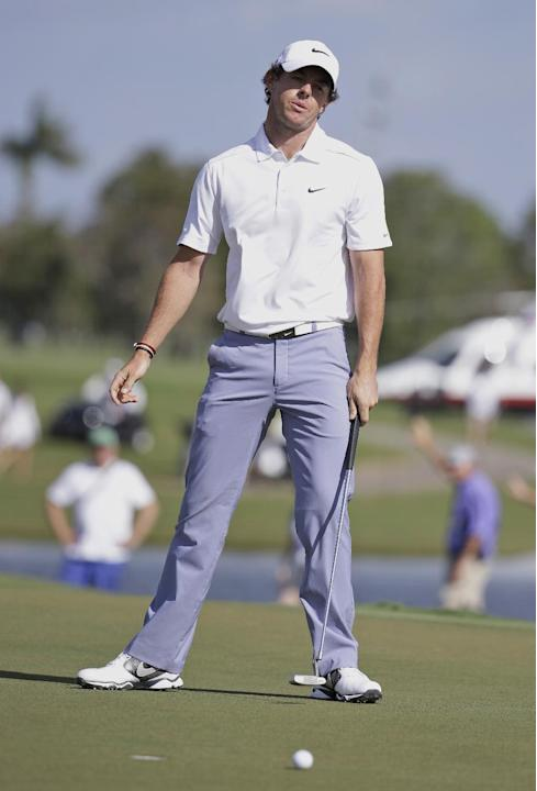 Rory McIlroy of Northern Ireland reacts after his ball misses the ninth hole during the first round of the Cadillac Championship golf tournament Friday, March 7, 2014, in Doral, Fla.  A severe thunder