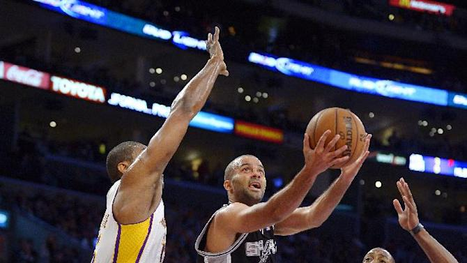 San Antonio Spurs guard Tony Parker, center, of France, shoots as Los Angeles Lakers forward Metta World Peace, left, and center Dwight Howard defend during the first half of their NBA basketball game, Sunday, April 14, 2013, in Los Angeles. (AP Photo/Mark J. Terrill)