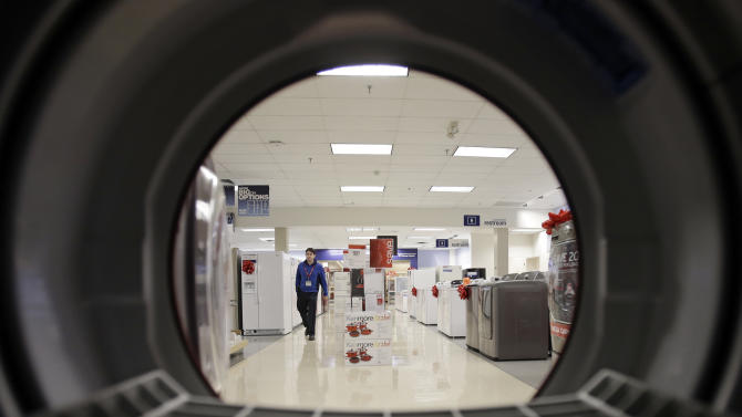 FILE - In this Dec. 6, 2012, photo, an employee walks through the appliance department at a Sears in North Olmsted, Ohio.  The U.S. economy grew at a slightly faster but still anemic rate at the end of last year. However, there is hope that growth accelerated in early 2013 despite higher taxes and cuts in government spending. (AP Photo/Mark Duncan, File)