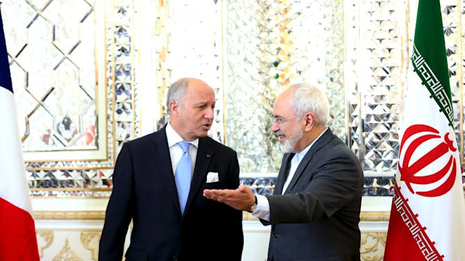 French foreign minister Laurent Fabius and his Iranian counterpart Mohammad Javad Zarif arrive for a meeting in Tehran