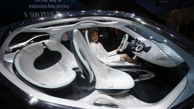 Smart CEO Winkler poses in a Smart Fourjoy during its world premiere at the Frankfurt motor show