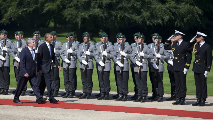U.S. President Barack Obama, second from left, is welcomed by German President Joachim Gauck at Schloss Bellevue on Wednesday, June 19, 2013, in Berlin. Obama will renew his call to reduce the world's nuclear stockpiles, including a proposed one-third reduction in U.S. and Russian arsenals, a senior administration official said. (AP Photo/Evan Vucci)