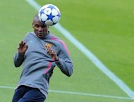 "Barcelona coach Pep Guardiola on Friday said he was confident that the club's French defender Eric Abidal, pictured here in 2011, will return to the pitch after a scheduled liver transplant, calling the player ""irreplaceable"""