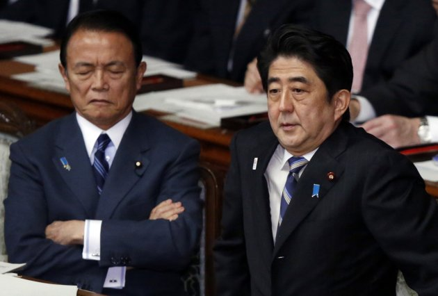 File photo of Japan's Prime Minister Abe and Finance Minister Aso attending a lower house plenary session at the parliament in Tokyo