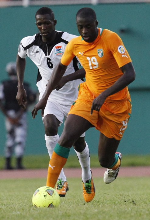Ivory Coast's Toure fights for the ball with Gambia's Marreh during their 2014 World Cup qualifying soccer match in Abidjan