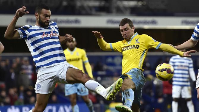 Queens Park Rangers' Caulker and Crystal Palace's McArthur challenge for the ball during their English Premier League soccer match at Loftus Road in London