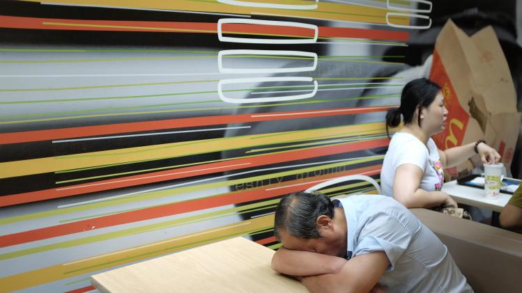 A man sleeps at a McDonald's store in Beijing