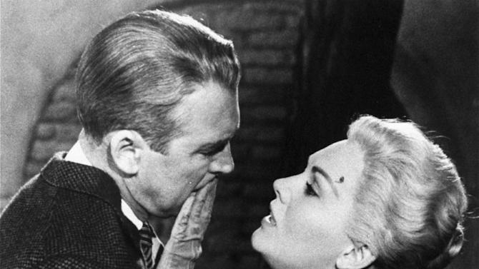 "FILE - This undated film image released by Paramount shows, Jimmy Stewart, left, and Kim Novak, in a scene from Alfred Hitchcock's 1958 film, ""Vertigo.""  (AP Photo/Paramount Pictures, file)"