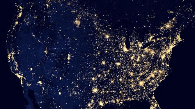 "This NASA image from a composite assembled from data acquired by the Suomi NPP satellite in April and October 2012 shows the United States at night The image was made possible by the new satellite's ""day-night band"" of the Visible Infrared Imaging Radiometer Suite (VIIRS), which detects light in a range of wavelengths from green to near-infrared and uses filtering techniques to observe dim signals such as city lights, gas flares, auroras, wildfires, and reflected moonlight. (AP Photo/NASA)"