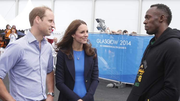 Britain's Prince William and Catherine, Duchess of Cambridge speak to Jamaica's Usain Bolt during a visit to the Commonwealth Games Village at the 2014 Commonwealth Games in Glasgow