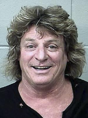 This July 9, 2012 booking photo provided by the Bangor, Maine, Police Department shows Mick Brown, drummer for classic rocker Ted Nugent, arrested in Bangor Sunday night, July 8, 2012, in Bangor. Brown, of Cave Creek, Ariz., was charged with driving drunk in a golf cart stolen from a concert venue. (AP Photo/Bangor Police Department)