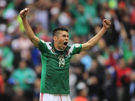 Mexico's Oribe Peralta celebrates after scoring against New Zealand during their 2014 World Cup qualifying playoff first leg soccer match at Azteca stadium in Mexico City November 13, 2013. REUTER