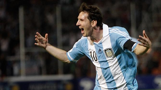 FILE - In this Oct. 12, 2012 file photo, Argentina's Lionel Messi celebrates after scoring against Uruguay during a World Cup 2014 qualifying soccer match in Mendoza, Argentina. Messi's shocking decision to stop playing for Argentina could further hurt his already tarnished legacy with his national team. If Messi sticks to his announcement, made in the heat-of-the-moment shortly after Argentina's penalty shootout loss to Chile in Sunday's Copa America final on June 26, 2016, Argentina will be left dwelling on the fact that it was not able to win any significant title while having one of the best players of all time.  (AP Photo/Eduardo Di Baia, File)