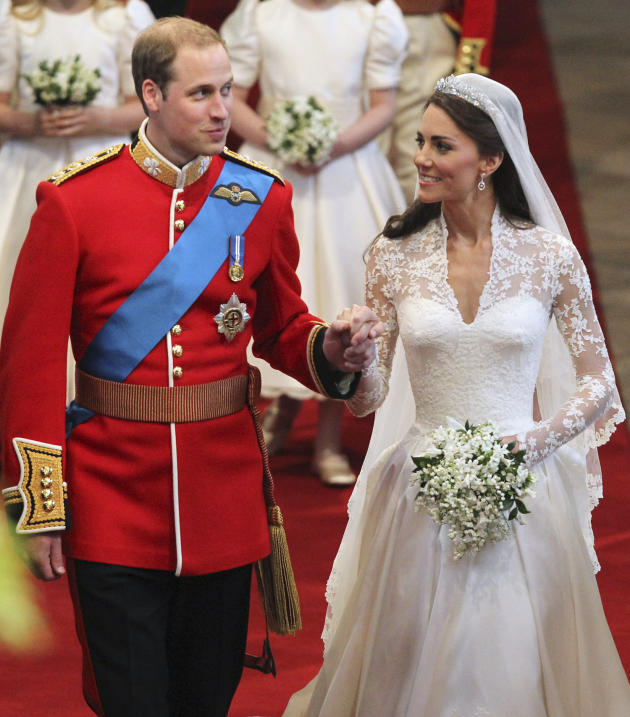 Britain's Prince William, left, and his wife Kate, the Duchess of Cambridge, walk down the aisle hand in hand following their marriage at Westminster Abbey, London, Friday, April 29, 2011. (AP Photo/D