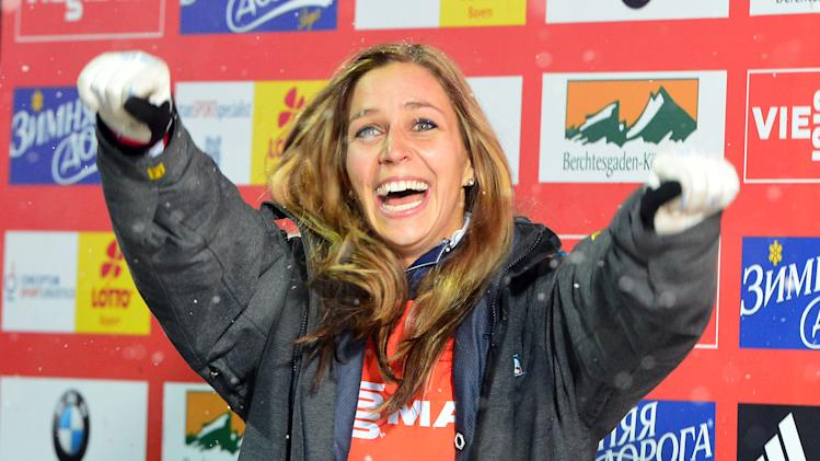Winner Noelle Pikus-Pace from the United States celebrates after the women's Skeleton World Cup race  in Koenigssee, Germany, Friday, Jan. 11, 2013. (AP Photo/Kerstin Joensson)