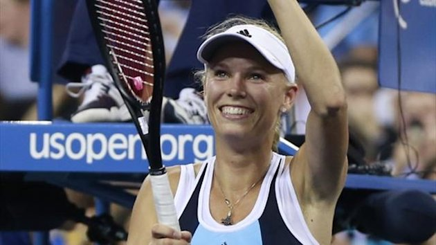 Caroline Wozniacki of Denmark celebrates winning her match against Chanelle Scheepers of South Africa at the US Open (Reuters)