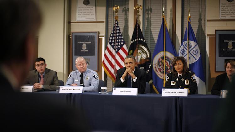 President Barack Obama, and others, listen to R. T. Rybak, left, during a roundtable discussion at the Minneapolis Police Department Special Operations, Monday, Feb. 4, 2013, in Minneapolis, Minn. From second from left are, Samuel Rahamin, Minneapolis Police  Officer Mike Kirchen, the president, Minneapolis Police Chief Janee Harteau, and Sen. Amy Klouchar, D-Minn. (AP Photo/Pablo Martinez Monsivais)