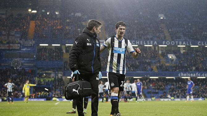 Newcastle United's Daryl Janmaat receives treatment after sustaining an injury