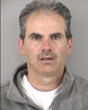 In this booking photo released by Kansas City Police, Anthony Falco is shown.  Falco, 47, is accused of trying to take a fake bomb through a security checkpoint at Kansas City International Airport on the 10th anniversary of the 9/11 terror attacks has a history of mental illness and recently quit taking his medications, the man's mother told investigators. (AP Photo/Kansas City Police)