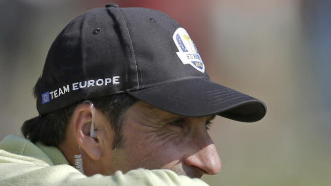 European team captain Jose Maria Olazabal watches from the 10th fairway during a four-ball match at the Ryder Cup PGA golf tournament Friday, Sept. 28, 2012, at the Medinah Country Club in Medinah, Ill. (AP Photo/David J. Phillip)