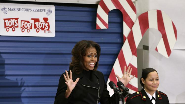 US First Lady Michelle Obama arrives to participate in Toys for Tots holiday campaign in Washington